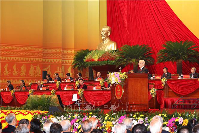 Đồng chí Nguyễn Phú Trọng, Tổng Bí thư Ban Chấp hành Trung ương Đảng, Chủ tịch nước CHXHCN Việt Nam đọc Báo cáo chính trị của Ban Chấp hành Trung ương Đảng khóa XII và các văn kiện trình Đại hội. (Ảnh: TTXVN)